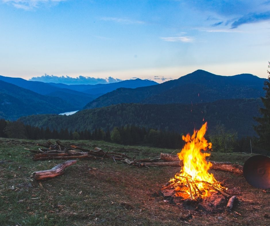 campfire with mountains in background